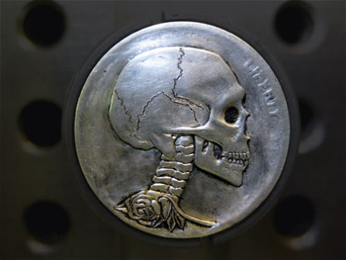 thievesnest:  Hobo Nickels are re-engraved/re-carved old buffalo nickels that were minted in the USA from 1917-1938. The tradition started during the Great Depression with the traveling Hobos who would alter the face of the nickel and then trade them for necessities.