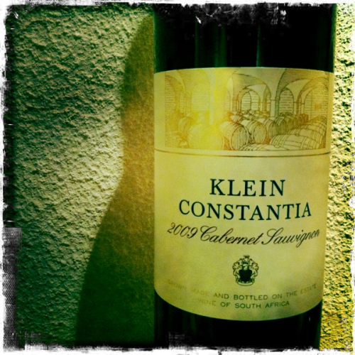 Klein Constantia Cabernet Sauvignon 2009  There's something very romantic about buying a bottle from the cellar door. Having just had a wonderful tour with Lowell Jooste (the MD of KC whose family recently sold the Estate) we did some tasting and this stood out as being good value.  This cost R150 from the cellar door, around £14 but it certainly drinks like a more expensive wine. It's very elegant with the right combination of earthy and fruity notes with a slight smattering of oak very subtly running through the wine. I don't think you get wines of this class at this price point from Bordeaux.   So far this is easily one of the better reds I've tried on the trip. I also highly recommend a trip to Klein Constantia. It's a beautiful vineyard which climbs up into the clouds at its highest point with stunning views of the Constantia region.
