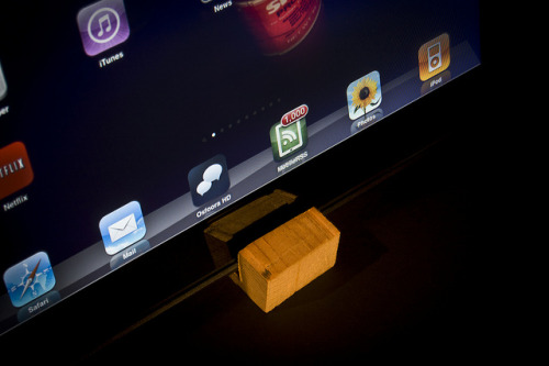 DIY iPad Stand by Pete Prodoehl on Flickr.Via Flickr: A simple iPad stand made from a piece of scrap wood. See the blog post: iPad Needs a Stand: rasterweb.net/raster/2011/01/18/ipad-needs-a-stand/