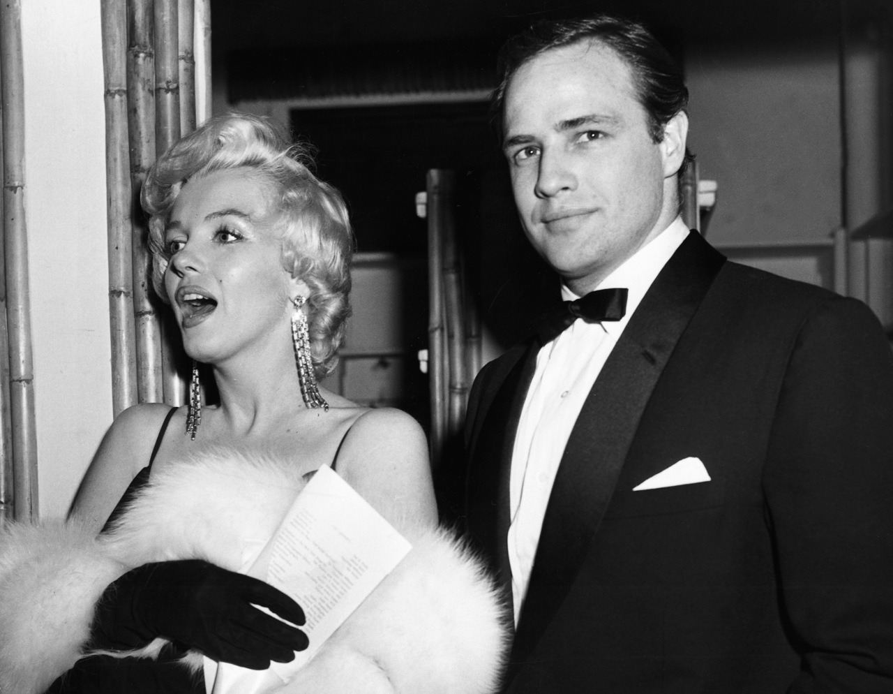 suicideblonde:  Marilyn Monroe and Marlon Brando at the premiere of The Rose Tattoo, December 13th, 1955