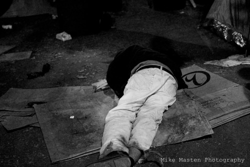 photographerlax:  Homeless man sleeping at Occupy Los Angeles protest.
