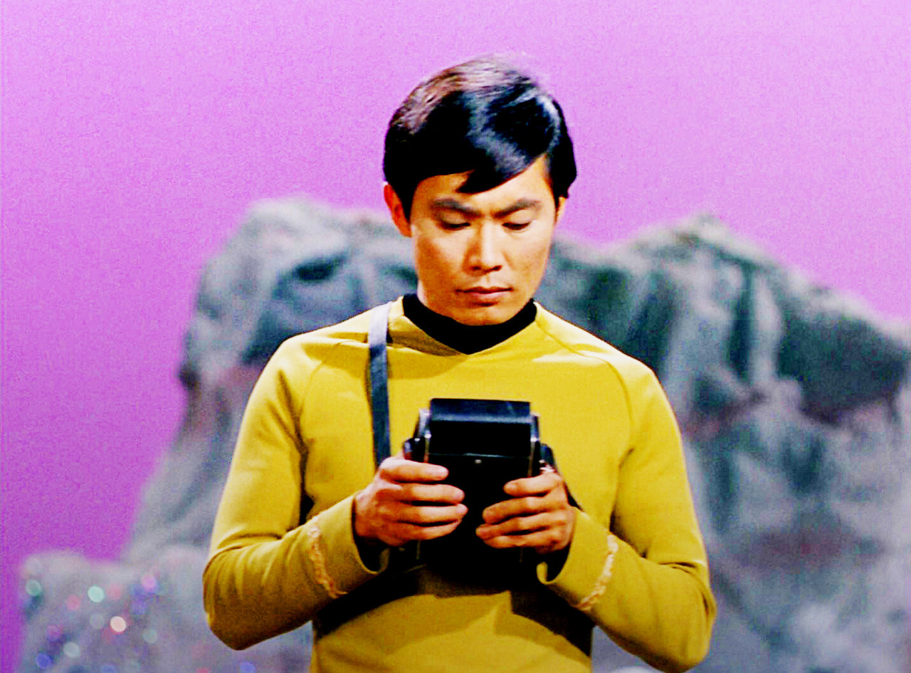 fuckyeahstartrektos:  He is so damn cute  LOVE HIM. And the colors in this photo. That is some purple.
