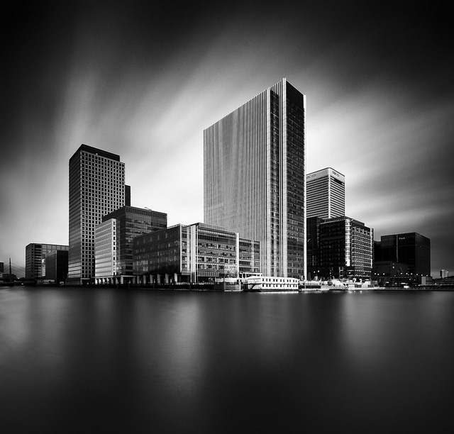 The Wharf on Flickr.This is along exposure Vertical Panorama (Vertorama) of Canary Wharf in London.  This has been quite a technical challenge, I had to take it as a vertorama and stitch two shots together to get around the massive convergence of the verticals I was getting at 10mm, so this is stitched and then cropped back to what I originally had in mind