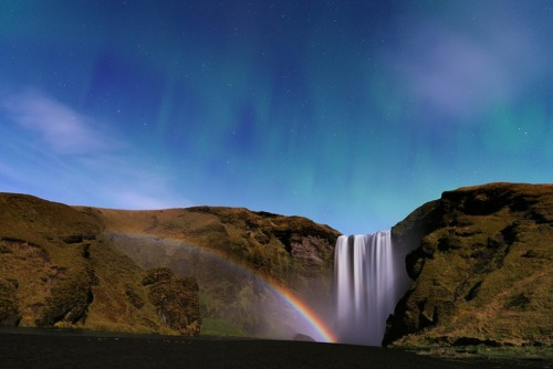 Night Time Rainbow at Skógafoss I've often pointed out the eternal rainbow by Skógafoss in countless other pictures. However, this is the first time I see a night time rainbow by it. You can see that this image is taken at night, because it also sports a aurora borealis in the starry sky. I once camped right in front of the waterfall and tried to capture some night photos, but came nothing close to this. Stéphane Vetter however had great success when he traveled to Iceland this October and took many excellent photos such as this one.  He captured the photo with a very long exposure, thus catching the otherwise invisible spectrum of faint aurora and moon light in the waterfall's spray. One of his other amazing photos is that of the aurora over Jökulsárlón glacier lagoon in Iceland. That photo was actually featured on the Daily Mail.