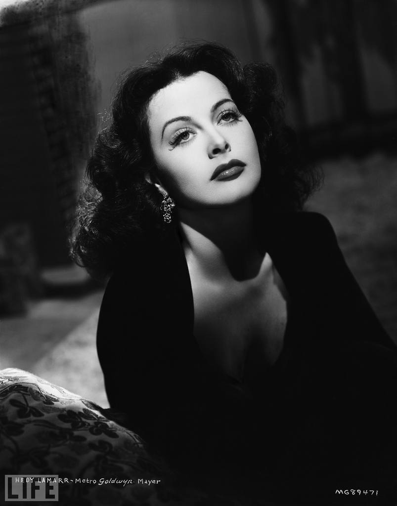 life:  Beauty AND brains — Not too shabby, right? Hedy Lamarr: Hollywood Sex Symbol, Tech Geek…She  was a glamorous movie star of the 1930s and '40s, a taboo-breaking  beauty who is credited with simulating the first on-screen orgasm (and  also appearing nude) in a 1933 film called Ecstasy. But Hedy  Lamarr was a trailblazer in more ways than one: Fascinated by science  and eager to find a way to help the Allies during World War II, Lamarr  came up with a way to make radio signals jump between frequencies, and  thus prevent the signals from becoming jammed. After Lamarr and a  partner obtained a patent for the invention in 1942, she gave it — at  no charge — to the U.S. Navy, which began using it in the 1960s. Today,  Lamarr's breakthrough is used in technology like the Bluetooth wireless  device. Get to know Hedy Lamarr, the world's sexiest inventor.  Have I posted here about Hedy Lamarr before? She was so awesome.