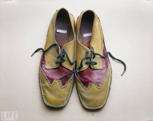 Shoes of the Very Famous Robert Frank's Red-and-Yellow Brogues, Circa 1974-1975 For all you photo nerds out there…  The groundbreaking Swiss-born photographer Robert Frank spent two years crisscrossing the United States, photographing all strata of society. In all, he shot some 28,000 frames. The result was his 1958 magnum opus called The Americans, a searing look at the contradictions of life in the U.S. Frank accidentally left these shoes at the Visual Studies Workshop in Rochester, N.Y., while working with film students in the mid-1970s.  See more: Shoes of the Very Famous