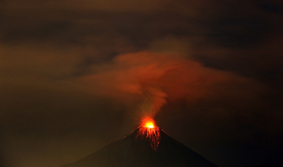 newsflick:  Authorities near Penipe, Ecuador upgraded a possible eruption warning from yellow to orange on Nov. 28, 2011, as the activity of the Tungurahua volcano raised suddenly. Ecuador's Geophysical Institute says increased activity that began Sunday is billowing columns of ash, sending superheated clouds of gas down the slopes and cascading hot rocks from the summit. (AFP)