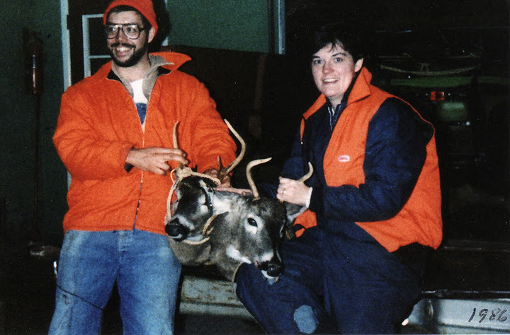 My parents, Jon and Deb Zinsli, with two white-tailed bucks, Spencer, Marathon County, 1986. The compulsory color of deer hunting apparel is known as blaze orange. via: personal collection of Beth A. Zinsli