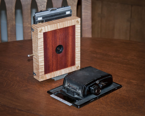 4x5 Large format pinhole camera. Handmade of figured maple and jatoba with an internal shutter. Uses both 4x5 sheet film holder and 6x9 Graflex back. An extremely wide angle camera, 25mm focal length.