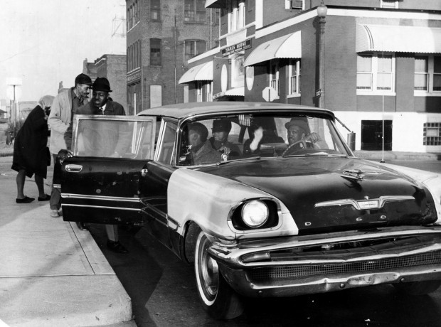 A former Consolidated Service Car Co. driver picks up customers at Ninth and Cole streets downtown on Dec. 7, 1965, a few days into the Committee of Racial Equality boycott of Bi-State Transit System to save what was left of service cars. In 1965, they charged 20 cents per rider. That was 10 cents cheaper that buses, but buses allowed free transfers. The defiant owner-operators erased Consolidated's name from their cars. (Lester Linck/Post-Dispatch archives) See more photos »