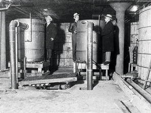 Prohibition officers raiding the largest distillery ever found in Detroit. January 5th, 1931