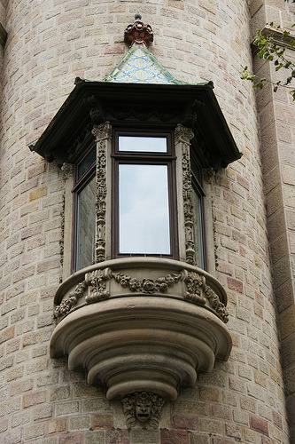 A beautiful oriole window from the Art Nouveau period on a building in Barcelona, Spain. The carved stone work and colorful tiled roof are gorgeous. (by jaime.silva)