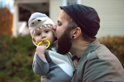 fyeahtattooedparents:  his tattoo is on his hand, and he's got gauges(: