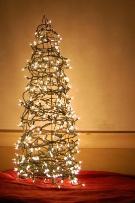 "unconsumption:  An upside-down tomato cage + strings of holiday lights = a fun (and easy-to-make) alternative Christmas tree. (Via Unconsumption's ""holiday things"" board on Pinterest, thanks to @imelda!)"