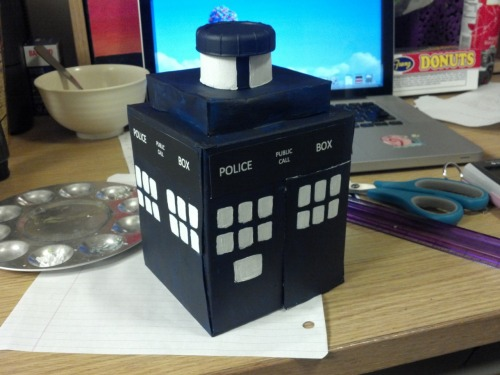 ohko:  TARDIS made from a Kleenex box, a paper towel roll, a bottle cap, and acrylic paint. :D  Actually, that is adorable. Even if it is geometrically incorrect. Love it.