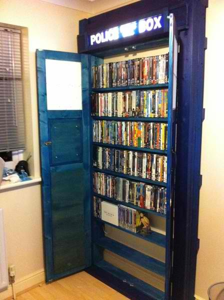 amandathefan:  doctorwho:  TARDIS DVD Closet nikkilynnh86:  I'd love to have this in my apartment.    when Slaur and I get a place together we will have this. Done.  OMG!