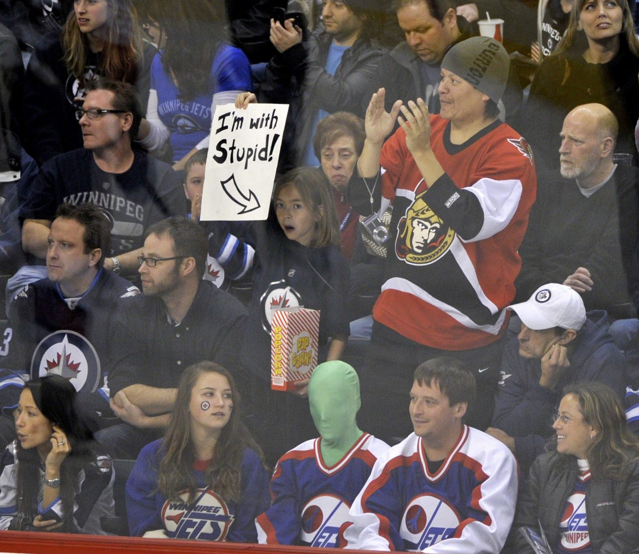 nationalpostsports:  Kicking off a road tripThis Senators fan may have been mocked by a small child, but Ottawa got the last laugh with a wild 6-4 win over the Jets in Winnipeg on Tuesday. Photo: Fred Greenslade/Reuters