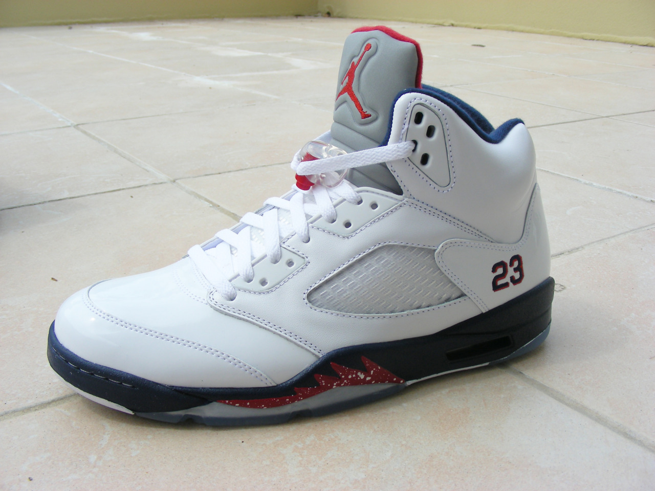 Air Jordan 5 White/Midnight Navy-Red. I got these for $154 since Foot Locker had an awesome 30% off for Christmas ^^