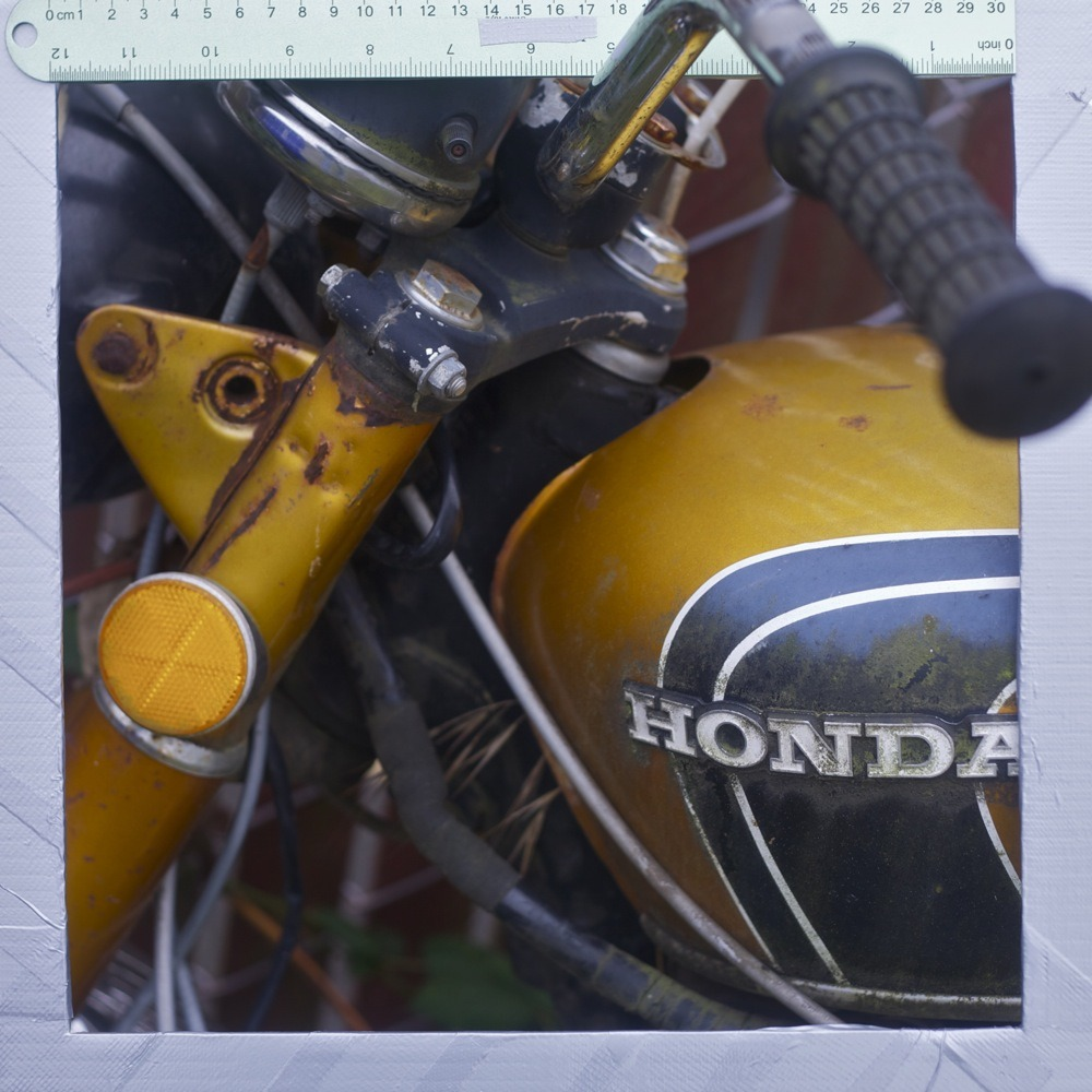 Rusted yellow Honda motorcycle, N Lombard/Lovely alley.