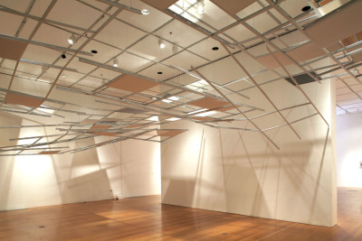"Photo: C. Ree, Overhead 2011 Disrupture Multimedia project installations, featuring works by C. Ree, Heather Sparks and Jenifer K. Wofford January 7th, 2012 through February 18th, 2012 Opening Reception: Saturday January 7th, 2012 6PM -10PM Closing Reception: February 18th, 2012 6PM-9PM icTus Gallery is pleased to present Disrupture, a collection of multimedia installations by C. Ree, Heather Sparks and Jenifer Wofford.  Please join us on Saturday January 7th, from 6-10pm for the exhibition opening. In the wake of Arab Spring and its waves of revolt, and Occupy movements in every corner of the country, the topic of political disruption has hopefully entered our daily dialogue. The artists in Disrupture take the conversation further, disfiguring the very spaces in which we live, upsetting the cherished ritual of shopping and depicting the greatest ruptures of all: the explosive volcano. By inflecting everyday spaces with both specters of past trauma and a presence which resists the rational, C. Ree's new installation work Overhead explores the monstrous underbelly of the heroic, and troubles the real into a space that is unexplainably urgent. She uses suspended ceiling components often found in mass produced spaces – both commercial and domestic – and incorporates dripping leaks from horror movies, fibrous tiles which sag over time, or mirrors which confuse vision and location. C. Ree filmed an accompanying video, Aimless Bullet, which documents a large-scale ceiling's complete destruction, single-handedly sabotaged by an unknown figure. As a meditation on consumption and desire, Heather Sparks developed the Big Return Project, a collective performance with participants across the US and parts of Europe. Inspired by her experience within the fashion industry, which she says ""de-mystified the lure of luxury brands"", Heather invited participants to shop and then return their purchases as performative actions, a binging and purging of a desire to consume. Documentation of actions, including a collective 'workshop' shopping experience, were uploaded and shared through social media, and were included in the performance series Capitalism is Over. The project continues, attracting new contributions and dialog. Moving from the disrupture of the material realm to one of the natural  realm, Jenifer K Wofford focuses her sights on rendering volcano plumes  in ink and acrylic works on paper. Part of a very new body of work begun  this year, Wofford has been constructing a global history of volcanic  eruption columns—or rather, the depiction of eruption columns, and the  ways in which these have been documented or retold in centuries of media  ranging from  imagined paintings and etchings of the AD 79 Mount  Vesuvius catastrophe to hyper-contemporary photography and video of the  2010 Eyjafjallajökull eruption. In part a formal challenge to render the  ephemerality of smoke and ash in a line-based drawing, Wofford's  Volcano project is also an enquiry into pressure, change, cataclysm and  consequence, and a study of natural phenomena on a global scale,  focusing on historic and recent eruptions in the Philippines, Iceland,  Indonesia, Japan and Italy. For more info see press page…"