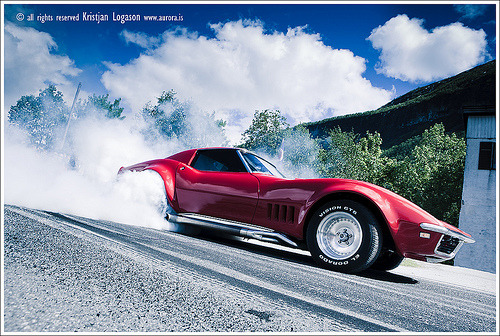 automotivated:  Red corvette burning rubber (by benzi the expedition truck travel)
