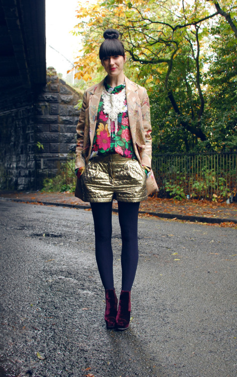 couturecourier:  Love the mix of bold textures, colors and patterns! Her sleek top knot (which is apparently a trend now) is the perf. hairstyle to show off her quirky style! (via Kingdom Of Style: Velvet   Gold)