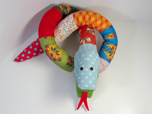 1.Fabric animals snake tutorial by FunkyFriendsFactory.com on Flickr.Via Flickr: Follow these simple steps to make a Silly Scrap Snake. I used this fabulous Flaming Cherry Tattoo Fabric by Voodoo Rabbit   …and added some bright fabrics from my scrap basket.  If you'd like to get the Silly Scrap Snakes Pattern pop over to the funkyfriendsfactory website… and if you sign up for the newsletter you can get the FREE Honey Teddy pattern too, so you can get started making your own toys right away! Happy sewing, Pauline
