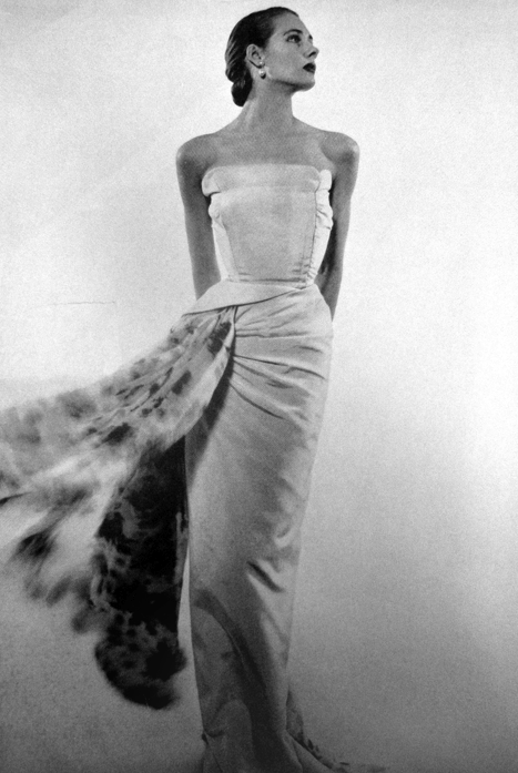 theniftyfifties:  Model wears an evening gown for Vogue Paris, 1951.