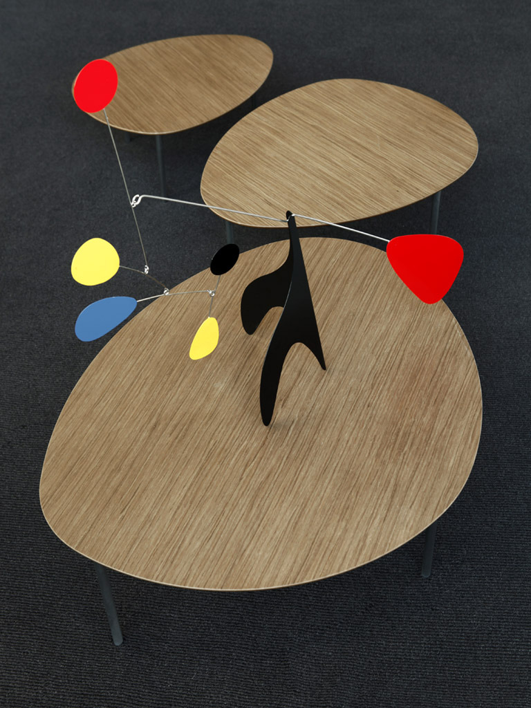 flasd:  Eclipse + Calder = Miro The Eclipse nesting tables from STUA and a mobile from Calder make this image that looks like a Miro painting.STUA Timeless Design Blog
