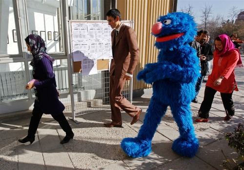 inothernews:   SUPER, GROVER   A familiar TV character walks with Afghans at the French Culture  Center in Kabul on Nov. 30.  Children in Afghanistan will be able to start their education as millions of preschoolers  elsewhere in the world have: by watching the TV show Sesame Street, which begins airing in the country on Thursday.  (Photo: Omar Sobhani / Reuters via MSNBC.com)   We always knew he'd make a good diplomat.