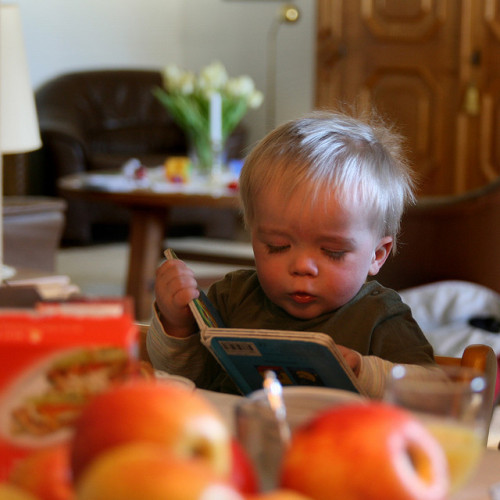 Reading his own book by basheem on Flickr.