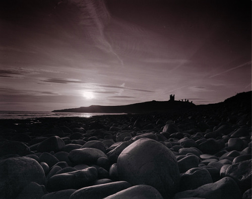 Dunstanburgh Castle - Black and White version HP5 by NGUSS on Flickr.