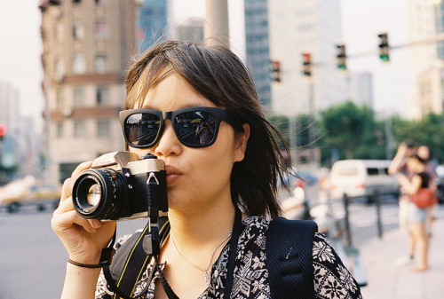 She looooves her camera by Woods | Damien | 大米 on Flickr.Via Flickr: Taken during our Film only Shanghai Flickr Meetup with an Olympus 35 SP. Roll #24 - Kodak Portra 400 pushed to 800 — Woods
