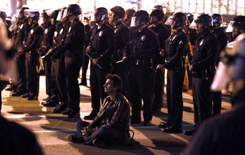 "thedailywhat:  Occupy Movement News Update of the Day: Just under 350 people were arrested in twin raids on Occupy encampments last night. In Los Angeles, more than 1,400 LAPD officers dismantled the Occupy LA encampment that had been set up on the south lawn of Los Angeles City Hall since early October. Some 290 people who refused police orders to evacuate were arrested.  A few protesters reported seeing scuffles, but National Lawyers Guild observer Pam Noles praised police officers, saying ""the LAPD had their A game on."" She also commended the protesters ""who stood on message, stood on discipline and stood on faith,"" concluding that ""[b]oth sides did what they had to do."" Mayor Antonio Villaraigosa also had kind words for his police department. ""I said that here in L.A. we'd chart a different path, and we did,"" Villaraigosa told reporters as he toured the messy grounds. Fences and concrete barriers were erected around City Hall, and it was unclear when protesters would be allowed back in to collect their belongings. Several dozen Occupy protesters with nowhere else to go sought sanctuary at the nearby Our Lady Queen of Angels Church. ""I hope it evolves in another direction because I don't think the police are going to let us continue a physical occupation,"" said protester Brendan Hainer. A General Assembly meeting is still scheduled to take place today at Pershing Square. The City Hall's ""free-speech zone"" will also remain open. A general strike at the Port of Los Angeles remains on the docket for December 12th. Meanwhile, in Philadelphia, a much calmer scene, as police entered the Occupy encampment near City Hall following an eviction notice that elapsed two days ago. 52 people were arrested after ""a chaotic night of cat-and-mouse,"" with police stalking protesters around the City Center from Dilworth Plaza to 15th Street. The most significant clash occurred around 5 AM behind the Inquirer building. Both sides sustained a few minor injuries. Several streets remain closed, and Police Commissioner Charles Ramsey said officers will stay at Dilworth Plaza as long as necessary. Related: Iraq war vet Scott Olsen, who was critically wounded during the Occupy Oakland raid, spoke on camera for the first time since the incident after returning to the scene of the now-dismantled Occupy Oakland encampment. [latimes / philly / cnn / usatoday / photo: latimes.]"