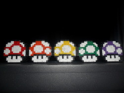 emmafuckingcauwelaers:  perler rainbow mario muschrooms n_n. Yes blue is missing because I gave ot to someone ^^ .