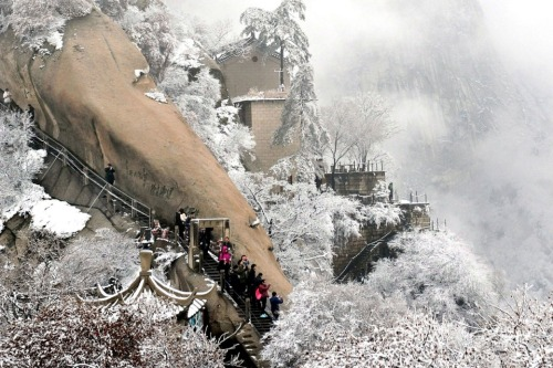 Xi'an, China: Visitors hike down snow-covered Mt. Huashan in China's Shaanxi province. (Nov. 30, 2011) Tao Ming, Xinhua / Zuma Press More Photos of the Day.