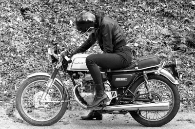 Honda CB200T, nice boots and shiny helmet.
