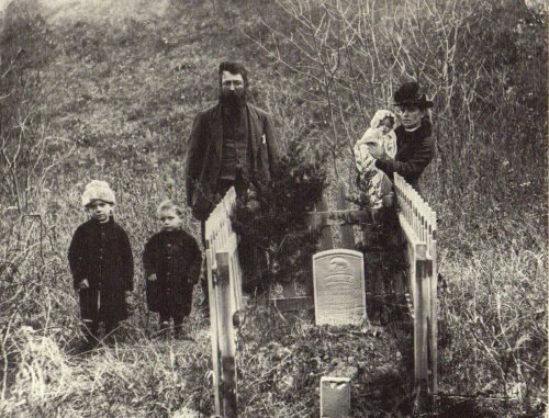 ca. 1887, [Portrait of the Harvey Andrews family at the grave of the youngest child], Soloman Butcher  via Secure the Shadow: Death and Photography in America, from the Nebraska State Historical Society, Jay Ruby