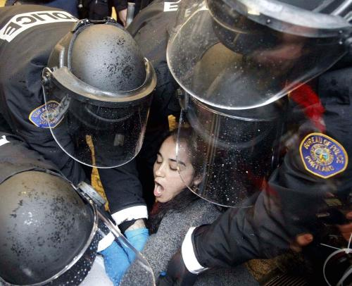 A Occupy Portland protester is arrested by Portland Police officers after       protesters take over a Wells Fargo bank Thursday, Nov. 17, 2011, in Portland,       Ore. Occupy Wall Street demonstrators held modestly sized, but energetic       rallies around the country Thursday to celebrate two months since the       movement's birth and signal that they aren't ready to quit yet,       despite police raids that have destroyed some of their encampments. (Rick       Bowmer)