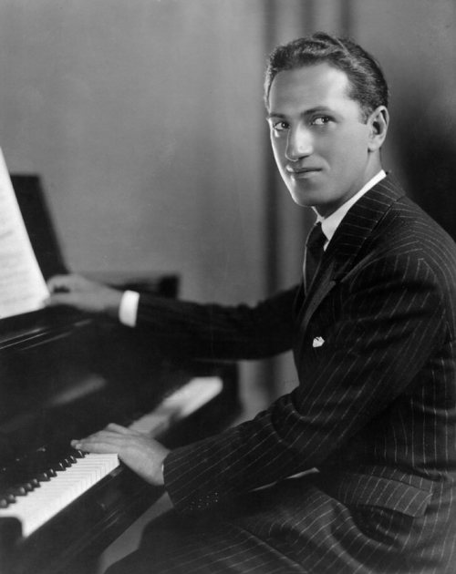 "George Gershwin, American composer. 1898 - 1937. Best known for classical works like ""American in Paris"" and ""Rhapsody in Blue,"" his opera ""Porgy & Bess,"" and standards like ""I Got Rhythm"" and ""They Can't Take That Away From Me."" What a stud. The man wrote everything. Ballet, classical, opera, jazz… His music is iconic and totally American. We lost a great man when he died of a brain tumor at age 38. Just think of how much better the world of music would be if he had lived even a few years more. Cheers to George Gershwin."