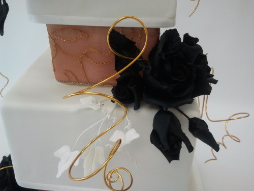 Black Rose wedding cake: Please don't judge my actual skills here — while I did decorate the cake and make the black roses, I did not fill or fondant it (I know, it's horribly done) or pick the design. I think the final product was interesting though, and lead to an obsession with black sugar roses…