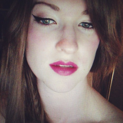 therealkatiewest:  Bright pink lipstick might be a fantastic new discovery for me. Channeling tangledupinlace for this.  (Taken with instagram)  i want to kiss all that lipstick off