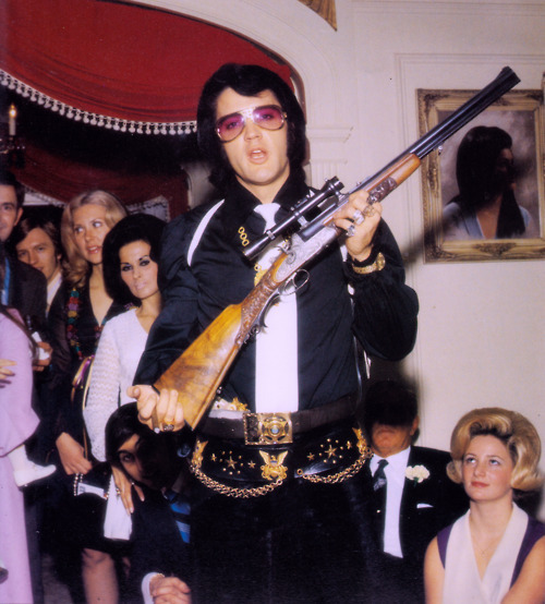 Happy Birthday, Elvis Presley! He'd have been 77 today. He enjoyed giving people guns. If he were with us today, he'd probably give you the gun off his back. suicideblonde:  Elvis Presley