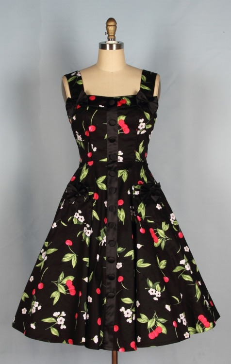 I just ordered this dress - I could resist the temptation of it no longer. (I have worked a shopping allowance into our household budget, but I always seem to spend it a week in advance. Oh well.) This dress looks absolutely gorgeous in the photo and if the fit and quality of the one Queen of Holloway dress I already have is any indication, it is going to be as gorgeous as it looks. I will definitely keep you posted.