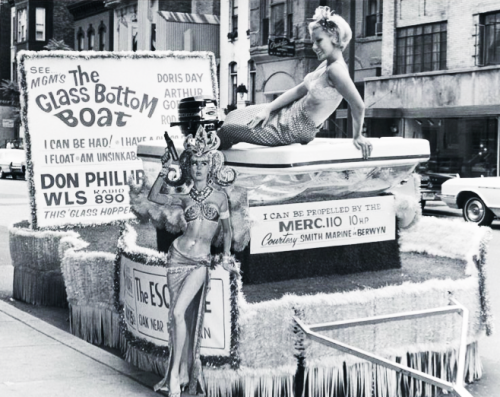 "A ""mermaid"" sits upon a float as publicity for The Glass Bottom Boat (1966)"