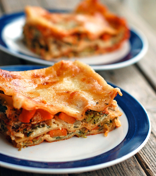 hello-delicious:  Vegetarian Lasagna Ingredients:3 cups chopped veggies of your choice1/2 chopped onion2 tablespoons minced garlic1 tablespoon olive oil1 cup low fat ricotta cheese1 egg2 cups fresh spinach2 cups tomato sauce12 uncooked oven-ready whole grain lasagna noodles1 cup mozzarella cheese, shredded Directions:Chop the veggies. Saute the onion and garlic in the oil over medium high heat. Add veggies and saute until tender. Set aside. Whisk egg into ricotta cheese and stir in fresh spinach. Pour a little sauce in the bottom of a greased 9×13 pan. Top with 4 lasagna noodles,1/2 cup ricotta mixture, 1/2 of the veggies, and 3/4 cup sauce. Repeat; top entire pan with noodles, remaining sauce, and mozzarella cheese. Cover and bake for 40 minutes at 375 degrees. Remove foil and bake for 10 minutes more or until cheese is bubbly.