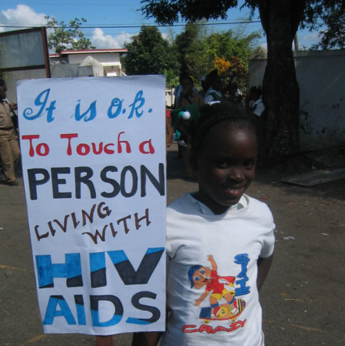 This was taken on World AIDS day in Jamaica on Dec 1, 2005. The students made posters then had a parade down the street and through the main square. The posters encouraged people to get tested and be accepting of those with HIV/AIDS. - Peace Corps Information Technology Volunteer Logan Steffens