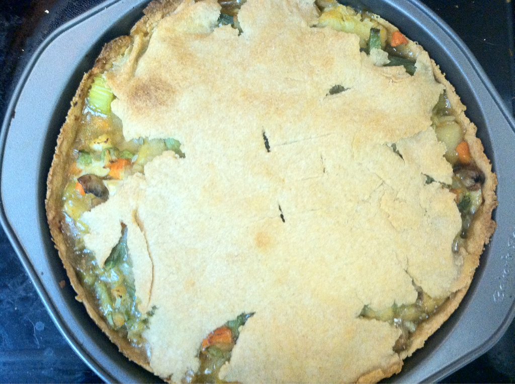 "Vegan Pot Pie 1 tablespoon of extra virgin olive oil 1 cup of mushrooms 1/2 of an onion, minced 1 clove of garlic, minced 6-7 baby carrots, diced 1 small potato, diced 1 stalk of celery, diced 5-6 florets of cauliflower 1 handful of uncooked green beans, diced 1 1/4 cups of vegetable broth 1 tablespoon of cornstarch 1 tablespoon of soy sauce 1/4 cup of water Salt and pepper to taste Crust for pie 1 cup of whole wheat flour (regular is fine, but I prefer whole wheat for this recipe) 1/2 cup of cold margarine (Earth Balance) 1/4 cup of cold water Preheat your oven to 420 degrees. Heat the olive oil and add onions, mushrooms, garlic, carrots and potatoes. Add the celery, cauliflower, green beans, and vegetable broth and bring to a boil. Reduce to simmer and in another bowl mix together soy sauce and cornstarch. Then add the water and mix until the cornstarch has completely dissolved. Add this mixture to vegetables, this will be the sauce. Season with salt and pepper. If you have a food processor, making dough is fairly easy. If you do not, I advise you to use a blender and a mason jar. If you don't have either, you can do this using two knives and it will take a bit of effort but it is not impossible. Attach the mason jar to the blade after pouring in flour and margarine. ""Blend"" them until they reach a sandy consistency. Remove the mixture from the jar and put in a bowl, and add the cold water. The dough should not be very sticky. Use more flour and roll out the dough big enough to fit inside a pie pan, cake pan, soufflé dish, et cetera. Put the vegetables from the pan in the pie pan. Leave some dough for the top, and roll out and place over mixture of vegetables. Bake for 30-35 minutes or until dough is golden brown."