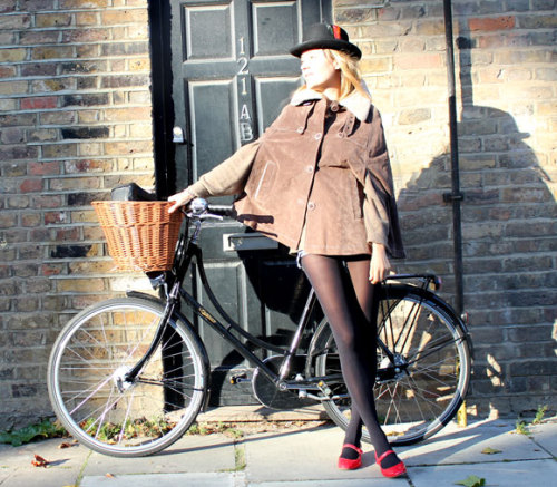 LOOK OF THE DAY: CYCLE CHIC Keeping warm and stylish while travelling around London; this look is relaxed and comfortable but the key is attention to detail and finding the perfect accessories. Team neutral colours and soft fabrics with cute details like the pretty red Office shoes matching the ribbon on the hat, and the delicate bracelets from the Rebellion and Bones collection. Cape Oakwood bought in Yube Madrid and a vintage hat. | THIS WEEK YOU MIGHT LIKE THIS |