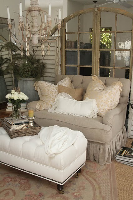 A wonderful overstuffed chair and footstool in neutral tones make for a relaxing sitting area (via Living and Dining Spaces / neutral but cozy)